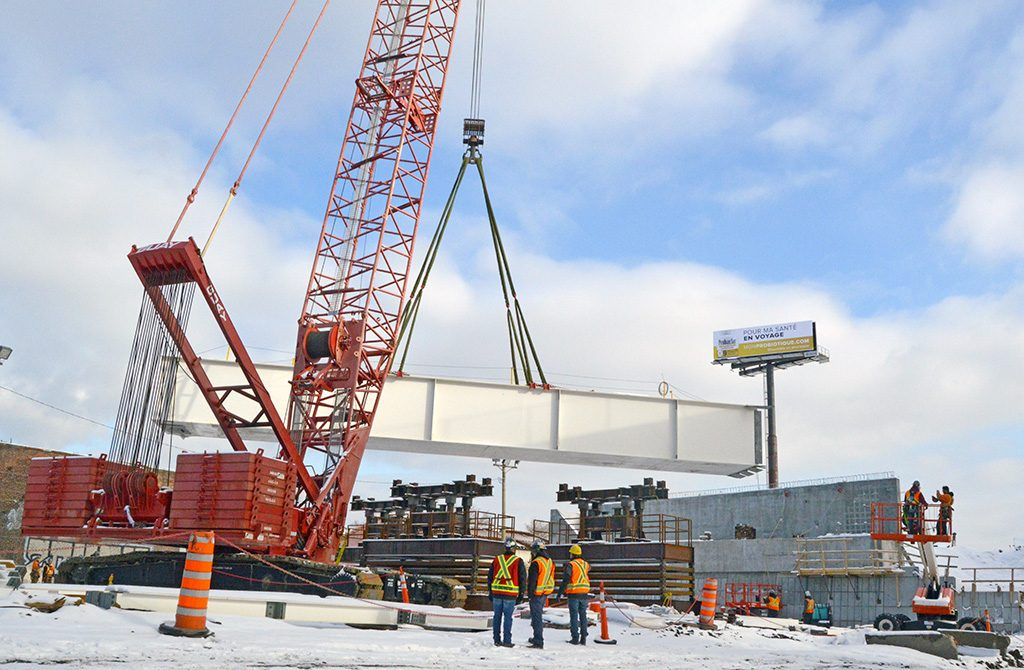 Turcot Interchange: Lifting of the First Girder of the New Bridge Above the Lachine Canal